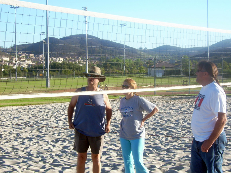 Mark (leader  of the Volleyball in the park activity), Kathy and David on the court ready to pick the teams for the first game