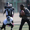 Reggie Bush (RB, Miami Dolphins) works with local football players from the American Football Union (AFU) clinic at Beihang University.