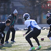 NFL player, Akin Ayodele works with local football players from the American Football Union (AFU) clinic at Beihang University.