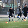 Local football players from the American Football Union (AFU) warm-up before clinic at Beihang University