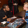 Ndamukong Suh (DT, Detroit Lions) chats with a young fan during a visit to the Shanghai American School. Photo credit: Shanghai American School (SAS) - David Mention