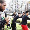 Ndamukong Suh runs through defensive linemen techniques with football players outside the Big Bamboo in Jinqiao. Photo credit: Andy Campbell - UTP Media