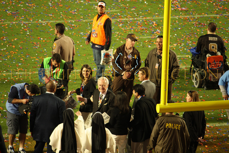Saints owner on the field