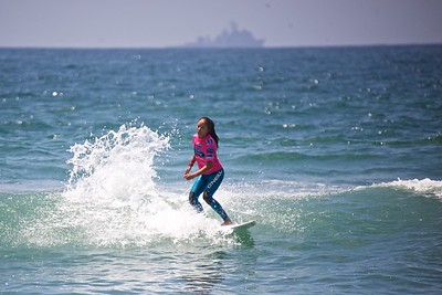Surfing day one of the Supergirl Pro 2013.
