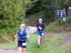 Wee!!!! Down the hill Deb and I run.  Note how well coordinated we are -- black and blue to match future bruising.