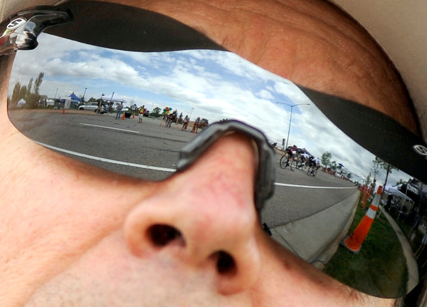 "The Pro Men racers are reflected in the sunglasses of Bill Simmons, of Superior, on Saturday, May 28, during the Summit Criterium Bike Race in Superior. Simmons had a son racing in the event. For more photos of the festival go to  <a href=""http://www.dailycamera.com"">http://www.dailycamera.com</a><br /> Jeremy Papasso/ Camera"