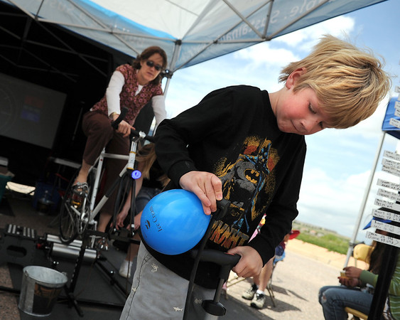 "QuinnRoberts, 7, of Superior, fills up his balloon with a bicycle pump on Saturday, May 28, during the Summit Criterium Bike Race in Superior. For more photos of the festival go to  <a href=""http://www.dailycamera.com"">http://www.dailycamera.com</a><br /> Jeremy Papasso/ Camera"