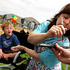 "Yvonne Larson, right, fills her brush with paint while painting a dragon design on Quinn McLachlan, 4, of Boulder, on Saturday, May 28, during the Summit Criterium Bike Race in Superior. For more photos of the festival go to  <a href=""http://www.dailycamera.com"">http://www.dailycamera.com</a><br /> Jeremy Papasso/ Camera"