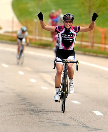 "Megan Hottman, riding for Team Primal MapMyRide, raises her hands in victory after winning the womens pro race on Saturday, May 28, during the Summit Criterium Bike Race in Superior. For more photos of the festival go to  <a href=""http://www.dailycamera.com"">http://www.dailycamera.com</a><br /> Jeremy Papasso/ Camera"
