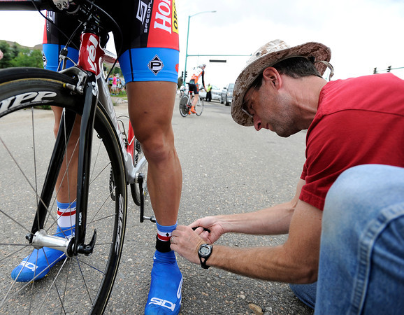 "Greg Cunningham, right, puts a timing chip on the ankle of Josh Yeaton during the Superior Morgul time trials on Friday, May, 18, in Superior. For more photos of the game go to  <a href=""http://www.dailycamera.com"">http://www.dailycamera.com</a><br /> Jeremy Papasso/ Camera"