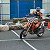 A Rider from RPM Supermoto demonstrates for the Gallery at the 2011 Motorcycle show