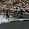 Paddle boarders on standing wave Glenwood Springs Co