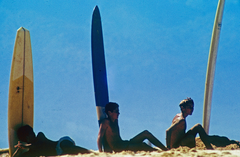 These were young surfers waiting for some waves at Sunset Beach Hawaii, long boards. 1967.