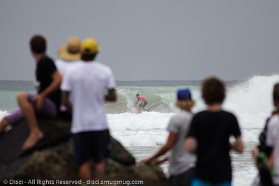 Onlookers clamber for any spot they can get, to see Joel Parkinson in action - Quiksilver Pro, Snapper Rocks, 27 February 2010.
