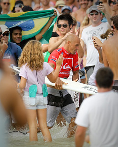 11 Times ASP World Surfing Champion Kelly Slater navigates his way through the large, enthusiastic crowd after the Expression Session - Quiksilver Pro final day 2012; Coolangatta, Gold Coast, Queensland, Australia; 04 March 2012. Photos by Des Thureson - disci.smugmug.com.
