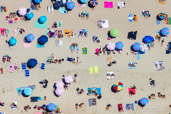 Beach-goers in Huntington Beach, CA