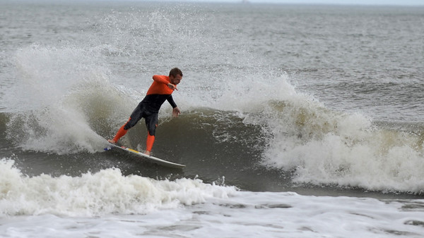 Surfing at Jacksonville Beach Pier in the middle of December, 2013.  It was almost 80 degrees.  :)