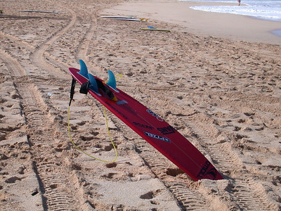 John-John's, and everyone elses' boards litter the beach in a mad dash to help find Malik.
