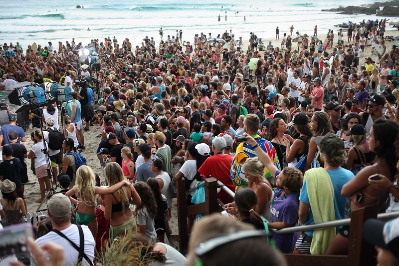 """Late afternoon presentations (with Brazilian fans in full voice too) - Nice crowd on the beach for the final day of the 2015 Quiksilver Pro and Roxy Pro Surfing at Snapper Rocks - 2015 Quiksilver Pro and 2015 Roxy Pro - general and wide angle photos - final day; Friday 13 March 2015; Snapper Rocks, Coolangatta, Gold Coast, Qld, AUS. Photos by Des Thureson - <a href=""""http://disci.smugmug.com"""">http://disci.smugmug.com</a>"""
