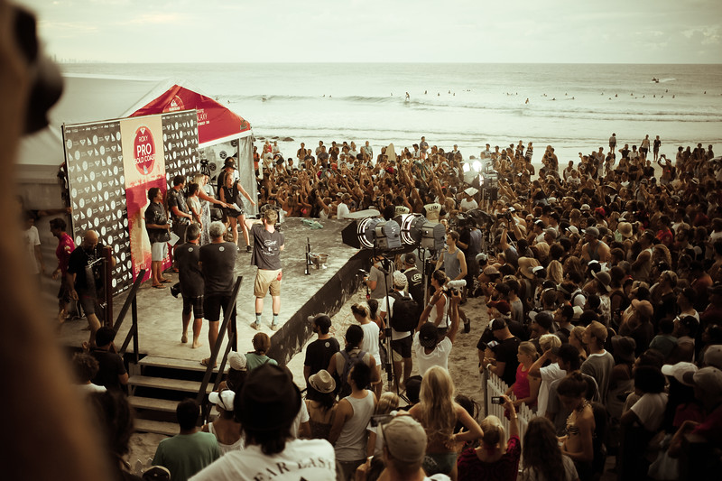 """Alternate Processing: yoshkiWarmGold - Late afternoon presentations (with Brazilian fans in full voice too) - Nice crowd on the beach for the final day of the 2015 Quiksilver Pro and Roxy Pro Surfing at Snapper Rocks - 2015 Quiksilver Pro and 2015 Roxy Pro - general and wide angle photos - final day; Friday 13 March 2015; Snapper Rocks, Coolangatta, Gold Coast, Qld, AUS. Photos by Des Thureson - <a href=""""http://disci.smugmug.com"""">http://disci.smugmug.com</a>"""