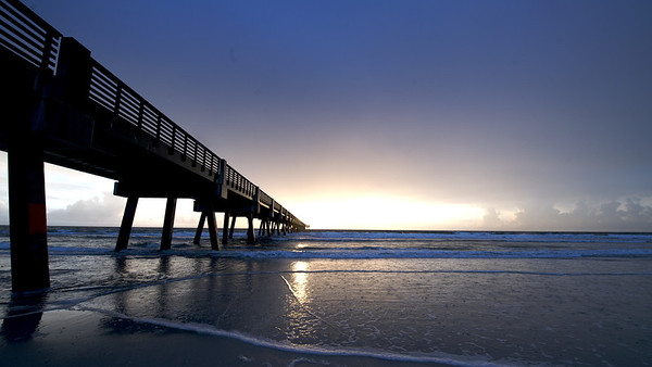 I went out and photographed the sunrise and surfers at the pier at Jax Beach for a few hours this morning.