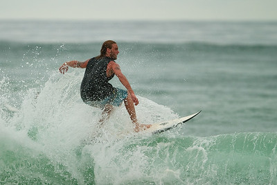 "Surfing Sunrise Beach at high tide on an overcast afternoon; ""Sunshine"" Coast, Queensland, Australia; 1 November 2010."
