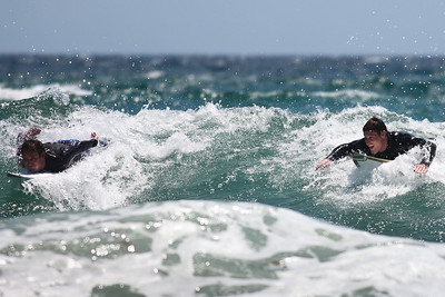 """""""I'll beat ya!"""" - Surfing Burleigh Heads on a choppy, windy day; 9 December 2009. Photos by Des Thureson."""