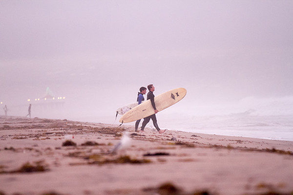 Early morning surf. Christmas tree lights on the Manhattan Beach Pier in the background.