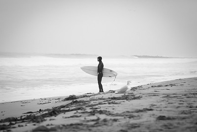 Surfer contemplates the winter waves at El Porto. Surfing the winter swell can be a challenge at El Porto when it walls out.