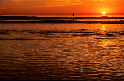 Sunset and a lone surfer.  North Swami's, Encinitas, California.
