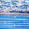 Close up view of beautiful blue ocean wave with white foam