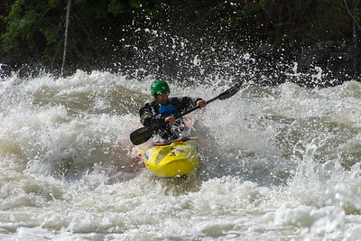 Kayaker navigates rapids on the Payette River, Idaho.