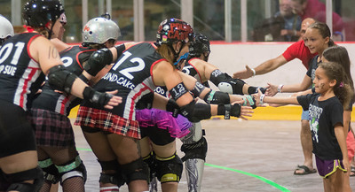 Susquehanna Valley Derby Vixens high five spectators before Saturday's bout with the Nightmare on Main Street team.