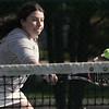 KEN YUSZKUS/Staff photo.   Swampscott's doubles player Sarah Cunningham hits one by the net during the Swampscott at Danvers girls tennis match.    5/8/15