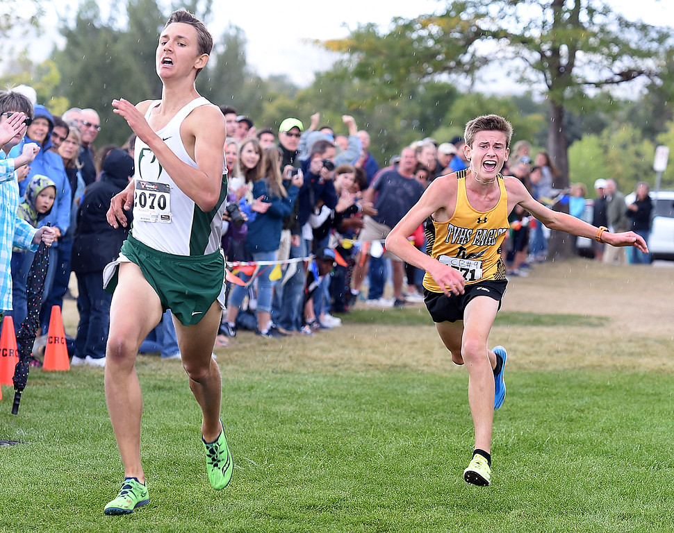. Thompson Valley\'s Dylan Shubert, right, tries to pass Fossil Ridge\'s Blake Hubert at the finish line Friday, Sept. 22, 2017, during the Sweetheart cross country meet at North Lake Park in Loveland. Shubert took second place in the meet.  (Photo by Jenny Sparks/Loveland Reporter-Herald)