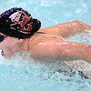 Olivia Loveless swims the butterfly leg of the 200 meter IM. Photo by Ned Jilton II