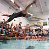 Swimmers dive from the blocks at the start of the girls 200 freestyle. Photo by Ned Jilton II