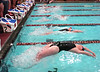 Swimmers break from the start for the backstroke leg of the 200 Yard Medley Relay at the Big 6 Swim Meet. Photo by Ned Jilton II