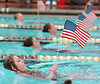 Tennessee High Swimmers form a color guard for the National Anthum before the start of the Big 6 swim Meet. Photo by Ned Jilton II