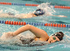 Dobyns Bennett's Laura McAdams holds a narrow lead over South's Christine Hitch in the Girls 200 yard freestyle. Photo by Ned Jilton II