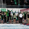 The Concord girls swimming and diving team reacts after winning the 400-yard freestyle relay, clinching the team title at the 2021 girls swimming sectional finals Saturday in Elkhart.