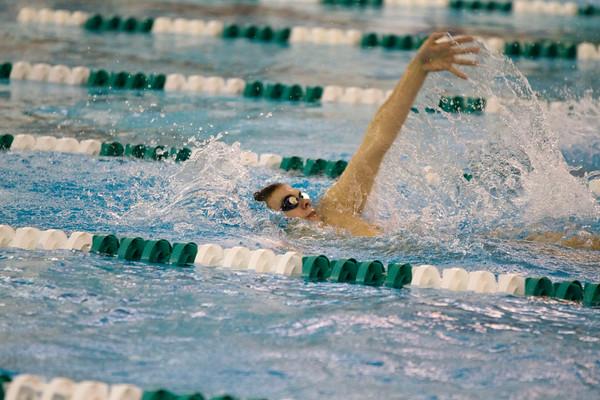 SAM HOUSEHOLDER | THE GOSHEN NEWS<br /> Concord swimmer Ryan Jackowiak competes in the 100 yard backstroke during the meet against Mishawaka Thursday.