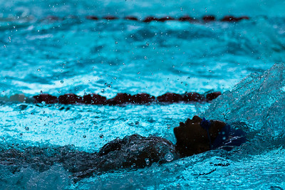 Interesting lighting during Pearce Mustangs Regional III swim meet in Rockwall.