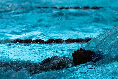 Interesting lighting during Pearce Mustangs Regional III swim meet in Rockwall.