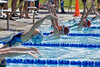Zoe (center, lane 4) and Eva (right, lane 3) start the 200m backstroke, 10 and under division.