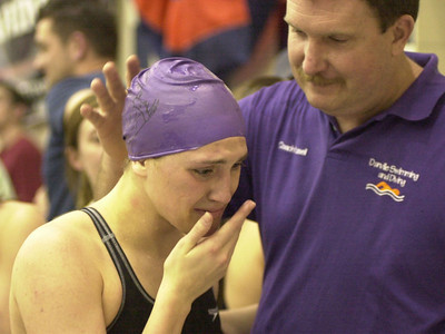 Danville's Ryan Kishbaugh was caught up with emotion while talking to her coach Dave Russell after she won the gold medal in the 100 backstroke in 2005. Kishbaugh, who later swam at Pittsburgh, won in 57.84 seconds.