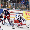 Chad Johnson barely gets his pad on a Syracuse shot,as the Crunch swarm the Wolf Pack crease.