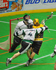 Syracuse Stingers Cam Simpson (2) is checked from behind by Vermont Voyageurs Ethan Farrell (4) in Professional Box Lacrosse at the War Memorial Arena in Syracuse, New York on Sunday, April 13, 2014. Vermont won 19-12.
