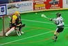 Vermont Voyageurs Jordan Loftus (34) fires a shot at Syracuse Stingers goalie Matt Ural (30) in Professional Box Lacrosse at the War Memorial Arena in Syracuse, New York on Sunday, April 13, 2014. Vermont won 19-12.