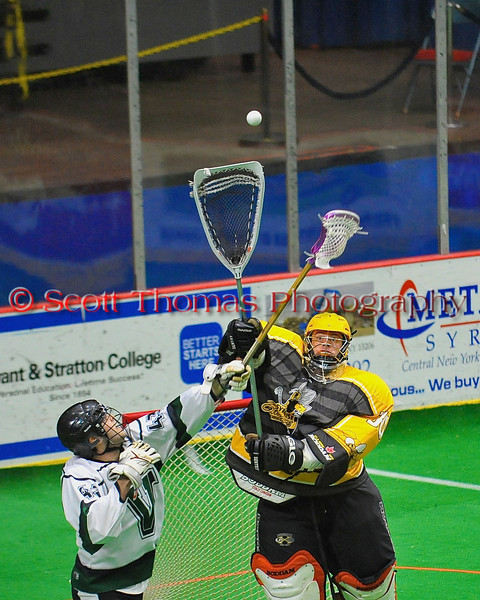 Syracuse Stingers goalie Matt Ural (30) passes the ball over Vermont Voyageurs Conner Roohan (43) in Professional Box Lacrosse at the War Memorial Arena in Syracuse, New York on Sunday, April 13, 2014. Vermont won 19-12.